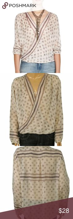 Free People Before Dawn printed wrap boho top Free People Before Dawn printed wrap boho top. Soft gauzy top. Size small. Long sleeve. Longer in back. Cover shot model is probably wearing an XS. Great condition. Free People Tops Blouses