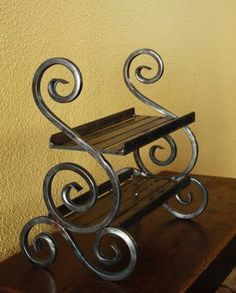 Wrought iron shelf by SteelCreating