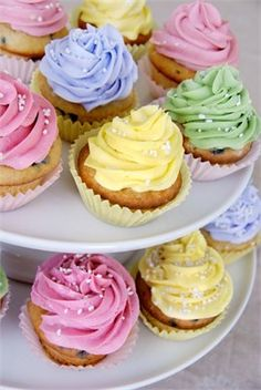 Ask a collection of close friends to help create a collection of wedding cupcakes that you can distribute on your wedding buffet.
