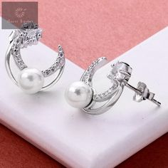Silver studs with pearls and zirconia stones attached that are attractive on modern women and girls #silver #silverjewellery #pearls #pearljewellery #zirconiastones #studs #silverstuds #beautifulearrings #silverstore #pearlearrings #silverornaments #pearlstuds #earringswithpearls #stonedearrings #earringswithstone