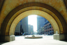 The City Hall archway at the intersection of Water Street, Market & Wells (facing south towards Wisconsin Avenue).