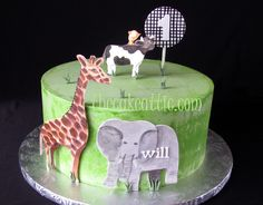 Giraffe, elephant and cow cake based on invitation. By thecakeattic.com in Salisbury, NC www.facebook.com/thecakeattic