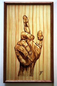 Pirograbado sobre madera de 20 x 30 cm.