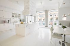 The Main Attraction - Explore Gwyneth Paltrow's Goop-Worthy  Tribeca Penthouse - white luxe modern kitchen
