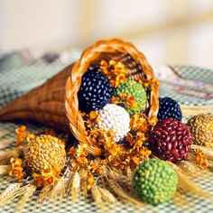 Create a Cornucopia of Seeds by gluing beans to foam balls.  Nice way to incorporate some variety and color.