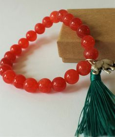 A personal favorite from my Etsy shop https://www.etsy.com/listing/230794401/beaded-gemstone-bracelet-with-tassel-and