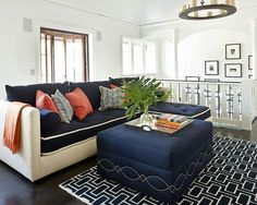 Deep sectional for sleeping.  Neutral base to keep it light and durable navy top and pillows with piping.