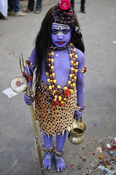 Little girl dressed as the Hindu God Shiva