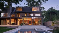 A shingle-clad addition is meant to mimic the scale and massing of a 1920s landmarked home, revamped by Canadian studio Drew Mandel Architects. Minimalist Fireplace, Toronto Houses, New Staircase, Marble Island, Dormer Windows, House Extensions, Architect House, Brick Building, Toronto Canada