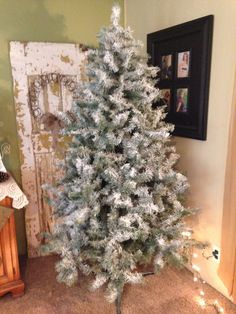 """Flocked Christmas Tree! Couple of cans of white spray paint ($1 each) and 2 cans of """"snow"""" from the Dollar General, and voila! Total cost $6 vs Hobby Lobby flocked tree @ $85"""