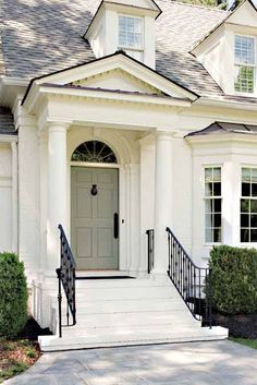CURB APPEAL – very appealing front porch and home. Simple and elegant entryway.