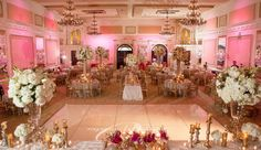 "The blush pink ballroom is the perfect reception venue for a princess bride! This photo is from the Grand Marquise Ballroom ""Where Romance Meets Elegance."" Located in Garner, NC."