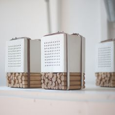Korean designers Joon&Jung have hand-crafted this set of speakers by strapping punctuated ceramic cubes onto a stack of twigs.
