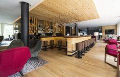 Admonter oak rustic floors and reclaimed wood hacked elements at Hotel Falkensteiner in Schladming Hotel Hacks, Hotels, Hotel Interiors, Designer, Flooring, Vacation, Wood, Rustic Floors, Table