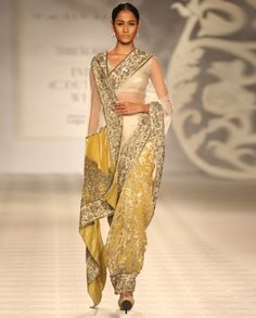 http://www.exclusively.com/yellow-sari-with-dabka-work?trk=more-like-these