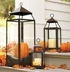 Love these pumpkins in the lanterns for the foyer. Is that coffee beans?