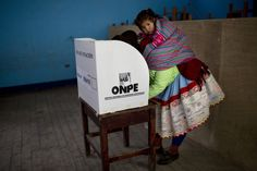 A Quechua indigenous woman casts her vote during general elections in Iquicha, Peru, Sunday, April 10, 2016. With the daughter of Peru's jailed former strong...