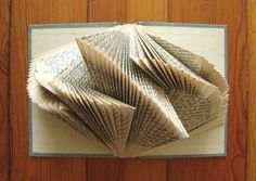 "By Betsy Jayne. Geometric Patterns in ""Exploded Books"". Via patternprints journal. More on site artist: http://explodedlibrary.tumblr.com/"