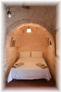 Bed nook inside a trullo.