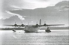 An Empire flying boat moored at Port Bell - PHOTO Imperial War Museum. The last flying boat to operate to South Africa and through Port Bell departed Southampton on November Wake Island, Boat Companies, Flying Boat, East Africa, Cool Tools, Historical Photos, Kenya, Colonial, Africa