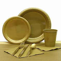 """The Gold Plastic Tableware Set includes everything you need for a party of 20. The durable Gold plastic party pack includes: Gold 7"""" Plastic Plates - package of 20, Gold 9"""" Plastic Plates - package of 20, Gold 54"""" x 108"""" Plastic Tablecover, Gold Plastic Cutlery - 24 knives, 24 forks and 24 spoons, Gold 12 oz Plastic Cups - package of 20, Gold Luncheon Napkins - package of 50, Gold Beverage Napkins - package of 50"""