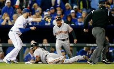 San Francisco Giants' Pablo Sandoval (48) is safe at third in the fourth inning of Game 7 of baseball's World Series at Kauffman Stadium in Kansas City, Mo., on Wednesday, Oct. 29, 2014. (Josie Lepe/Bay Area News Group)