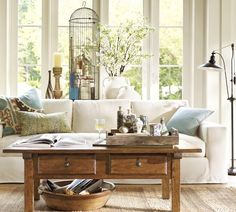 My ideal living room. Light and neatly cluttered.