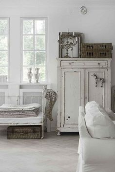 pale quilts and aged furniture. I want a cabinet like this to store fat quarter fabrics! Loooove it!