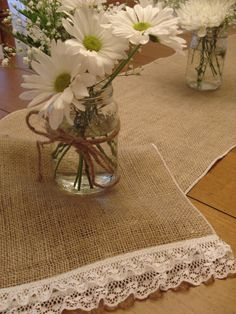 Linen and lace.  Burlap table runner edged in lace.