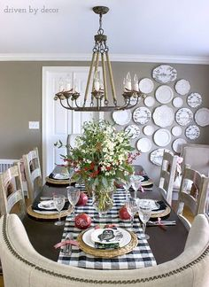 Dining room decorated for Christmas - love the black and white mixed with the green and red. And that plate wall!