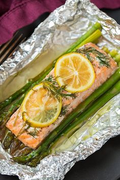 Pin for Later: 17 Exciting Tinfoil Dinner Recipes Perfect For Summer Campfires Salmon and Asparagus Packets Cooking this recipe in a foil pouch keeps the salmon moist and full of flavor.
