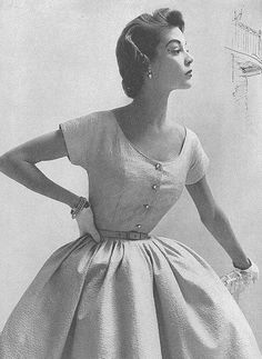50's dresses were shaped like hour glass formations in perspective of sheer beauty.