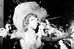 Dotty Harmony takes a pie in the face as she introduces comedian Ernie Kovacs, onstage at the Tropicana Hotel in Las Vegas, 1957
