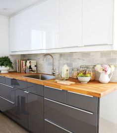 Kitchen Updating Ideas Basement kitchen design (tips from designer Samantha Pynn): White Upper Cabinets - Chatelaine - Samantha Pynn turns a below-ground apartment into a polished European-style kitchen. Find out she created this basement kitchen design. High Gloss Kitchen Cabinets, White Gloss Kitchen, Upper Cabinets, European Kitchen Cabinets, Dark Cabinets, Handles For Kitchen Cabinets, Ikea Cabinets, Basement Kitchen, New Kitchen