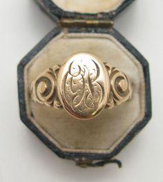 Gold monogram ring.