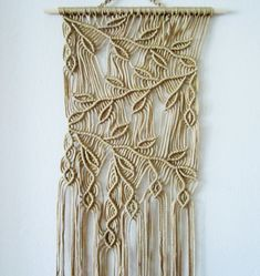 "FREE SHIPPING WITHIN USA  Macrame wall hanging - Sprigs #2 - unique and stylish wall decor for your home or office. Handmade, original idea and design by Evgenia Garcia.  Color: tan  Sizes: Dowel width – 18.5 (47 cm) Panel height from dowel to longest end – 47.5"" (121 cm) Cord diameter 4 mm  NOTE:  1. The colors on your display may differ slightly from actual colors. 2. Clean the dust with a soft brush gently.  If you have any questions about this item - please contact me. I am ready to help…"