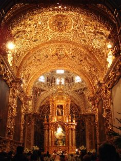 Capilla del Rosario, Puebla Mexico - one of the most elaborately decorated Baroque chapels in Mexico. The walls and dome are completely coated with ornate sculpture in gold leaf and plaster, including saints, cherubs, and dancing angels. On the walls, golden vines form the frames of six paintings depicting the mysteries of the rosary.