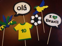 """DIY Brazil Photobooth Props! Made from simple sheets of foam and dowel sticks. We used these as props as our end of the year Brazil Day Research Project Celebration! Props include - #10 Brazil National Team Soccer Jersey, Parrot, Soccer Ball, Carnaval Headress, """"Olá"""" and """"I heart Brasil"""" Speech Bubble."""