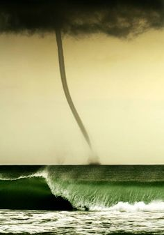 Waterspout...possible sisters based upon the funnel cloud above the water surface to the left of the formed waterspout.