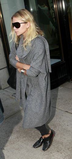 Ashley Olsen in an oversized cardigan and studded oxfords.