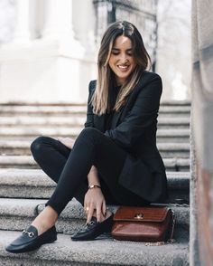 Alba Hervás wears loafers in a classically cool style; paired with skinny black jeans and a pin stripe blazer. Keeping the look all black results in definite sophistication. Shoes: Anna Xi, Bag: The Code Place.