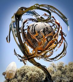 Giant kinetic, organic shaped metal sculptures by Patrice Hubert - Bleaq