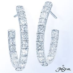 Style 2399 Stunning diamond hoop earrings handcrafted in platinum with 32 perfectly matched radiant diamonds in shared-prong setting.