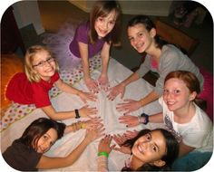 """""""spin the nail polish!""""  {various colors of polish, played like """"spin the bottle,""""  when the polish lands on you, you paint a nail that color, and so on.  For 'tweens"""