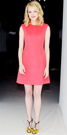 Emma Stone viewed the Calvin Klein Collection runway show in the label's red dress and colorblock Roger Vivier heels.