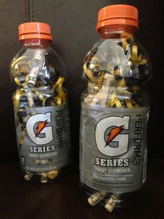 Coaches gifts - team color ribbon & rolled $10 bills in a Gatorade bottle. A fun way to give coaches cash gifts