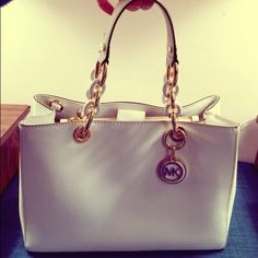 Michael Kors Cynthia satchel Beautiful Michael Kors handbag in white color. I took the tags off and decided it's not for me. It's in excellent condition never used before. The zipper still has wrapper around it. Comes with dust bag and longer strap. Michael Kors Bags