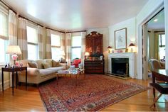 An antique Persian Heriz carpet with an all-over design makes an elegant statement in this living room. http://alixunlimited.com/