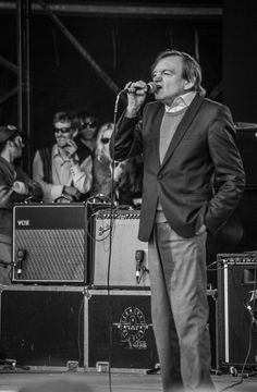 Mark E. Smith of The Fall during their set on The Park Stage, Glastonbury Festival 28/06/2015. By Mike Atkinson Photography.
