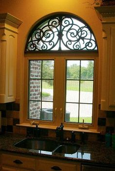 Iron arch...would like to replace my old farmhouse window with one like this!